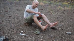 Waschung der staubigen Beine